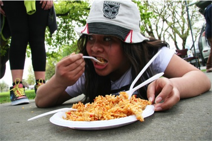 Year 11 Riccarton High School student Miroyda Brunt scoffs chilli rice for the team in Christchurch's Amazing Race challenge. PHOTO: Daniela Maoate-Cox